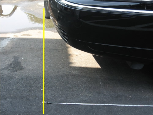 Line up front of measuring tape with front of limo